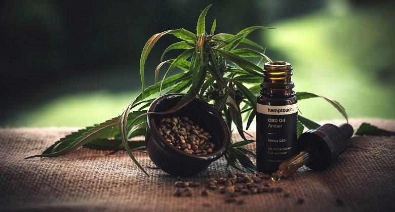 Cannabis leaves on hessian bag with cbd oil