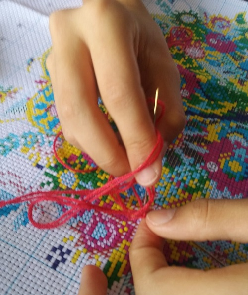 Cross stitch being stitched