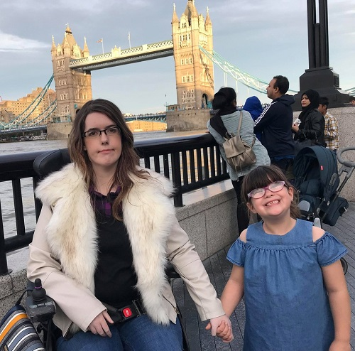 Fi Anderson in her wheelchair with her daughter in front of Tower Bridge in London