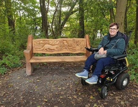 Lucy Currier in her wheelchair in the woods