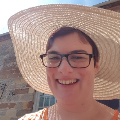 Lucy Currier outside in a sunhat