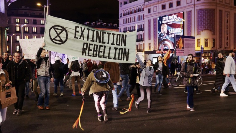 Extinction Rebellion sign at protest in London at night