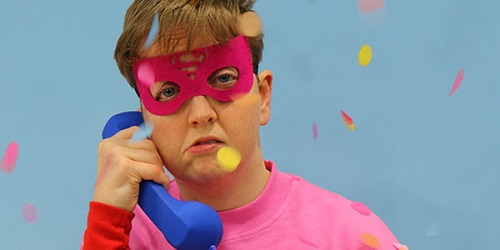 Man with pink outfit and eye mask as advert for show Scrounger
