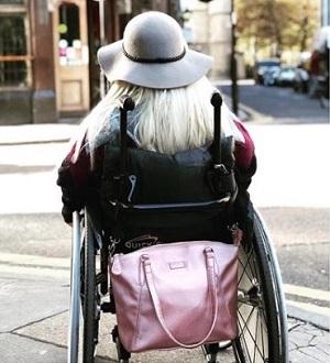 Sam Renke accessible handbag on the back of her wheelchair