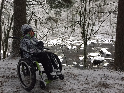 Andrew sat in the MT Push all-terrain trike in snowy Scotland