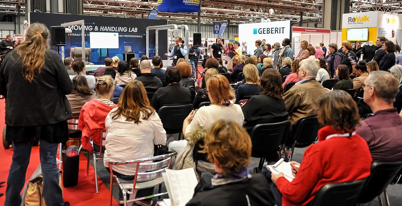 Crowd of people listening to a seminar at Naidex