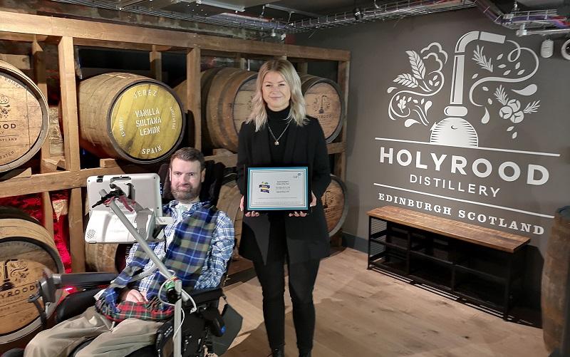 Holyrood Distillery award presented by Euan MacDonald
