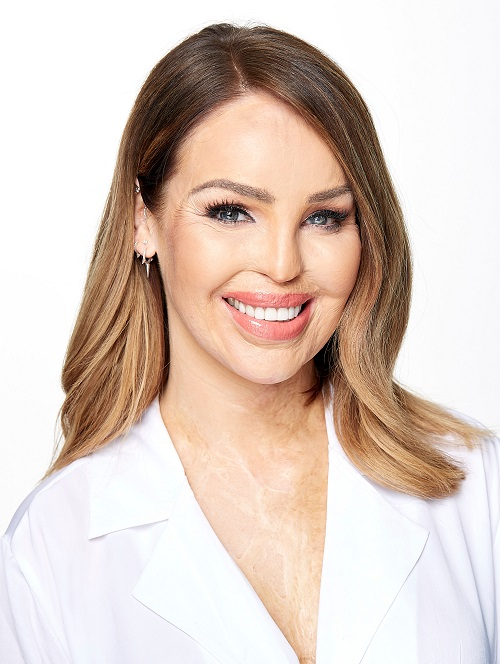 Katie Piper in a white top on a white background