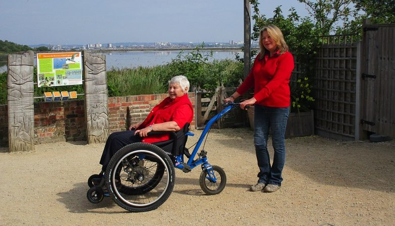 Two women using MT Push designed for both rider and pusher