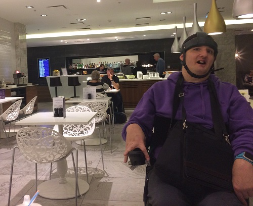 Simon in a restaurant on his cruise
