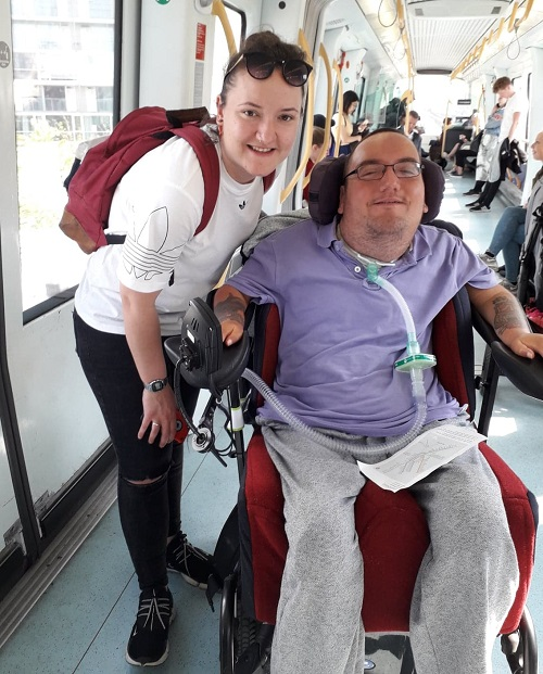 Wheelchair user Derry and his PA on an accessible train in Copenhagen