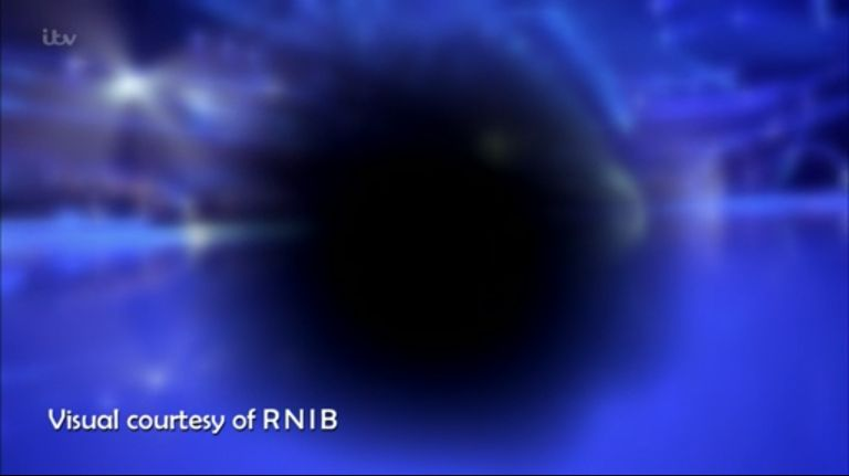 A black circle in the centre of the screen with some colour around the sides. Visual courtesy of RNIB