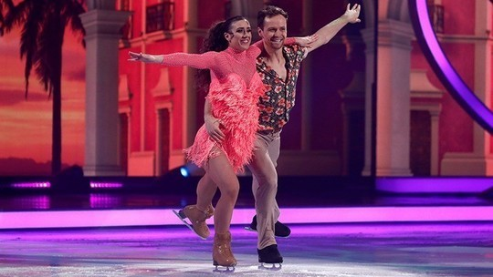 Libby and Mark in salsa outfits