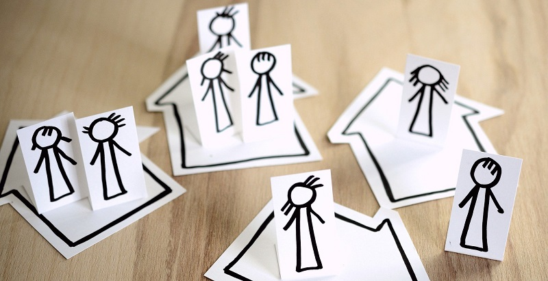 Drawings of stick people in houses self isolating