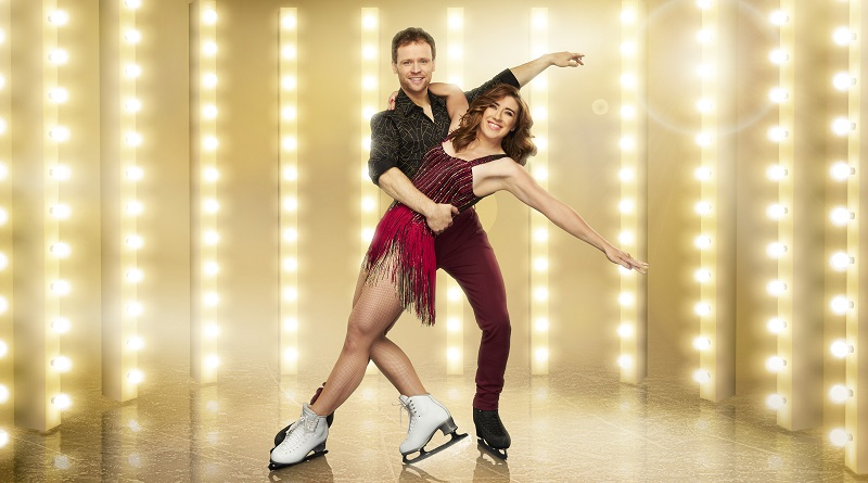 Libby Clegg and Mark in front of lights for Dancing on Ice
