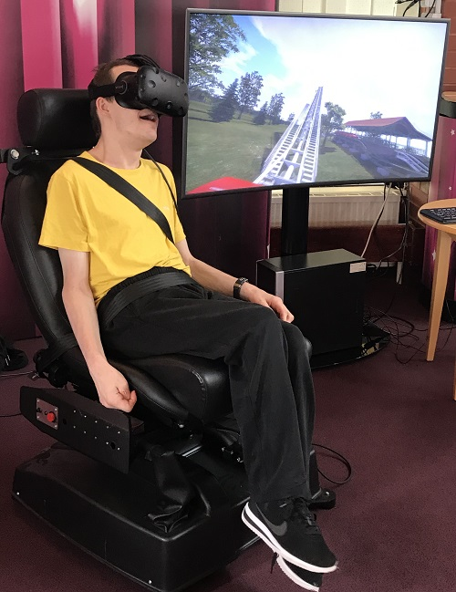 Disabled man using virtual reality at Revitalise accessible holiday