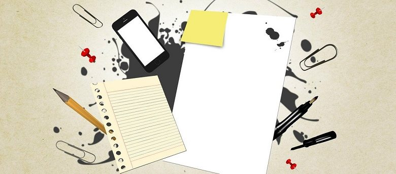 Graphic showing a writing pad, mobile, pen, paper clips and drawing pics