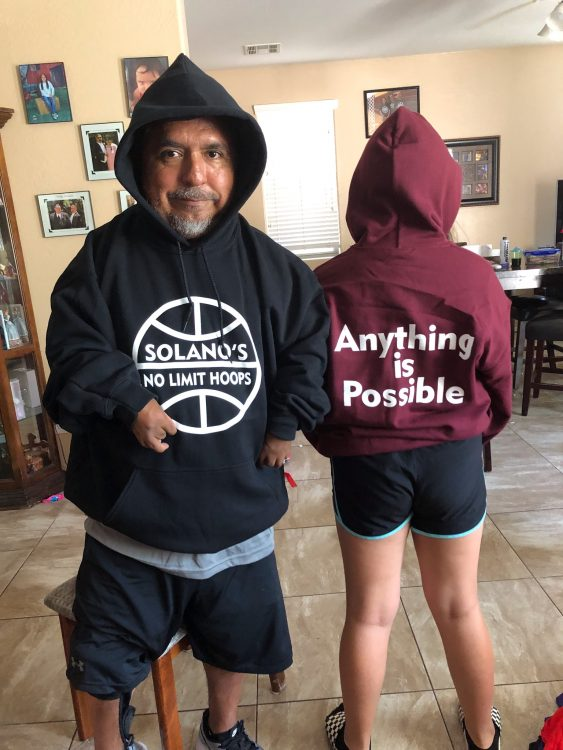 David wearing sweatshirts that say Solano's No Limit Hoops and Anything is Possible