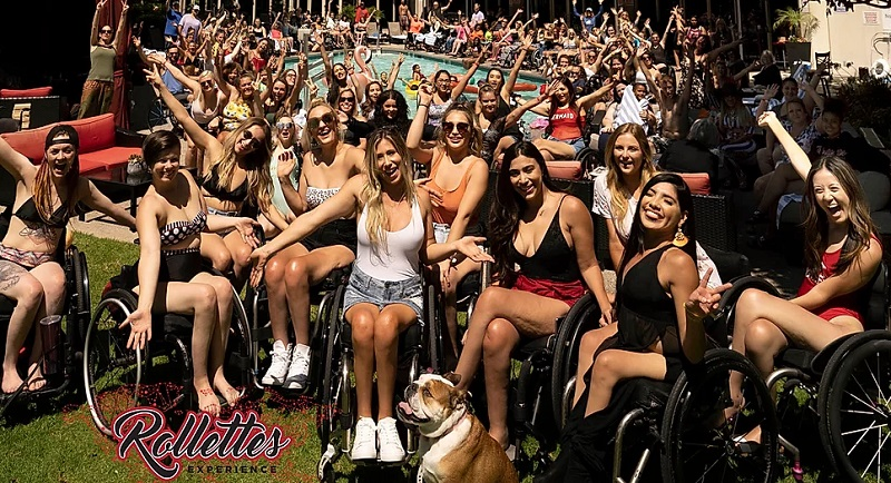 Hundreds of women in wheelchairs at a Rollettes Experience event