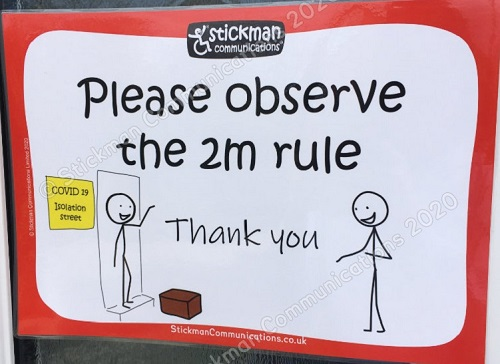 Stickman Communication sign saying please observe the 2m rule