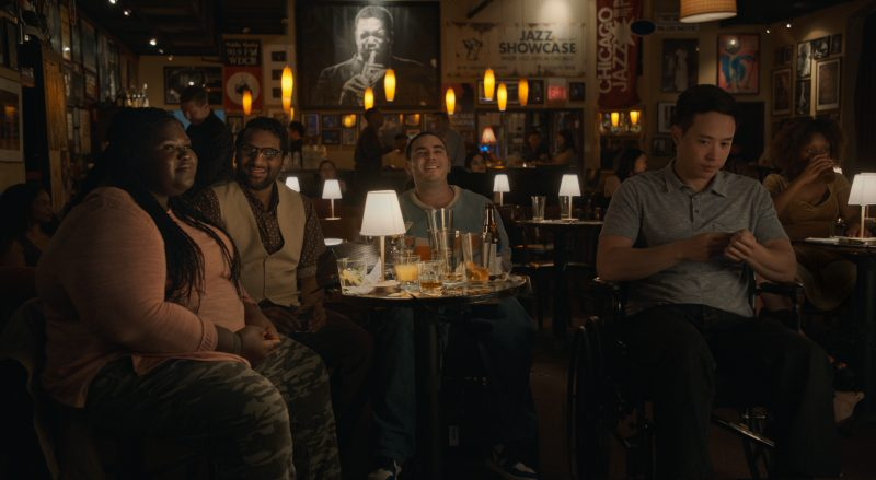 The men and Sam at a bar