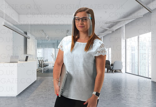 Young woman in an office wearing the Crystal Gaze face shield