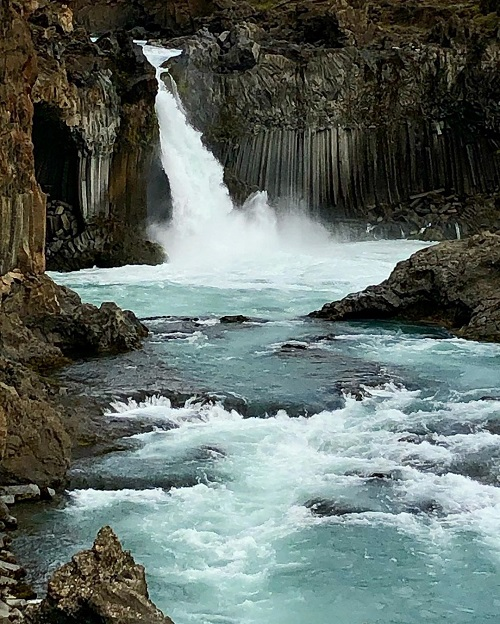 Image taken by blind photographer Roesie Percy of a waterfall in Iceland