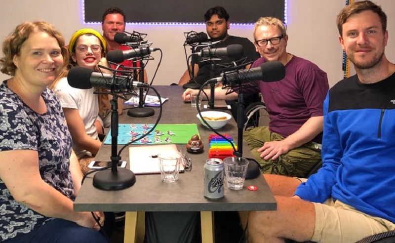 Ruth sat around a table with her fellow podcast makers recording This is Spinal Crap