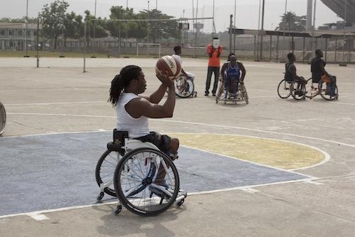 Ade Adepitan playing basketball