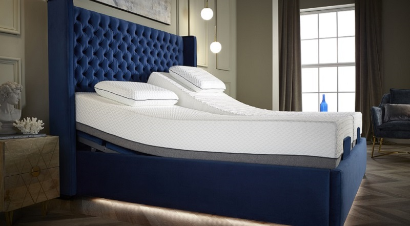 Double profiling bed covered in deep blue fabric from Opera Care