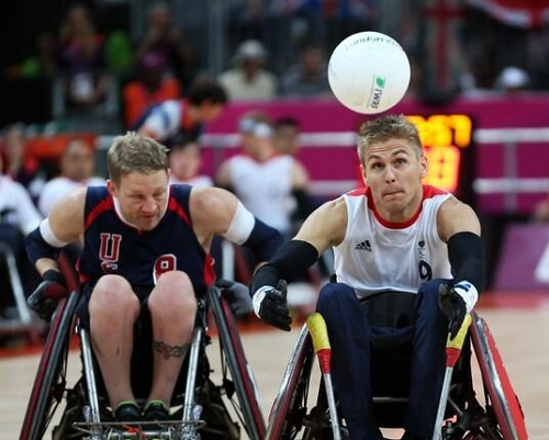 Steve Brown on the court playing wheelchair rugby at the Paralympic Games 2012 with him about to catch a rugby ball in the air