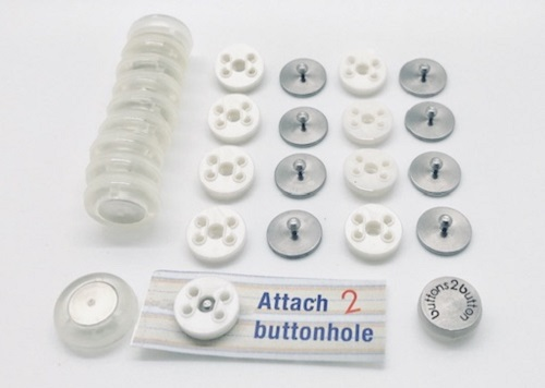 Buttons 2 Button adaptive magnetic buttons laid in rows on a white background