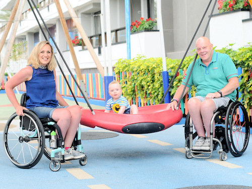 Disability Paradox - Two manual wheelchair users posing at event