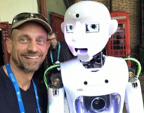 Freddie next to a white robot