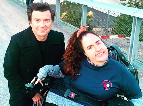 Georgina Moore in her wheelchair with Rick Astley