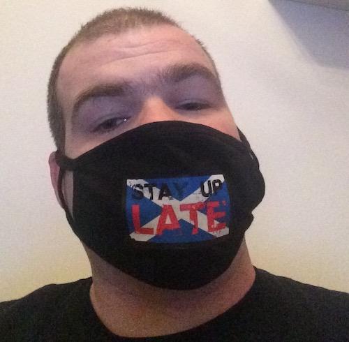 Michael Ewan in a face mask
