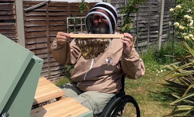 Zec Richardson in wheelchair bee-keeping