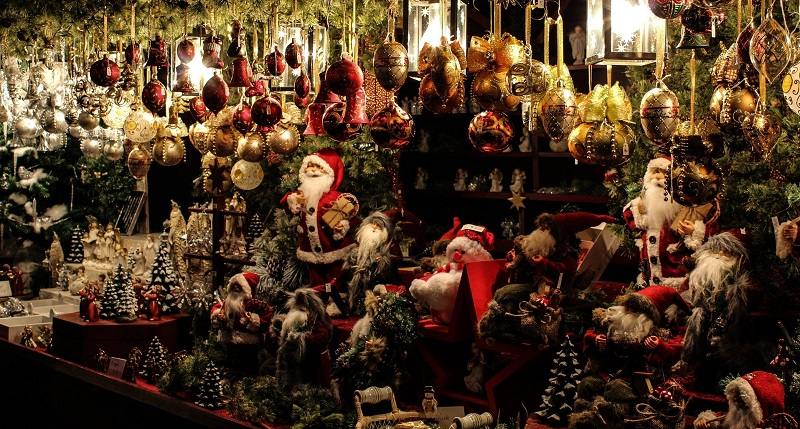Christmas market stall filled with baubles and Santa statues