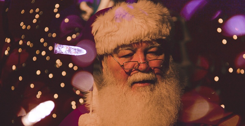 Father Christmas with Christmas lights in the background