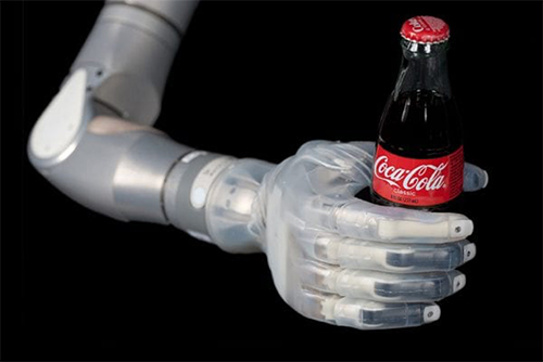 Bionic hand is holding a bottle