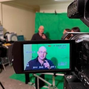 Blind filmmaker Gough filming in front of a green screen