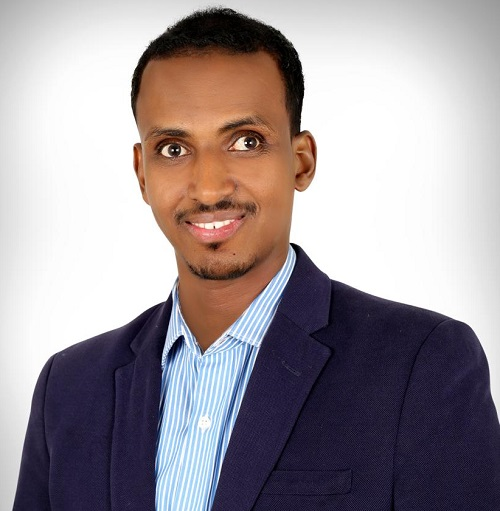 Yahya Siyad wearing a navy blue suit and light blue shirt