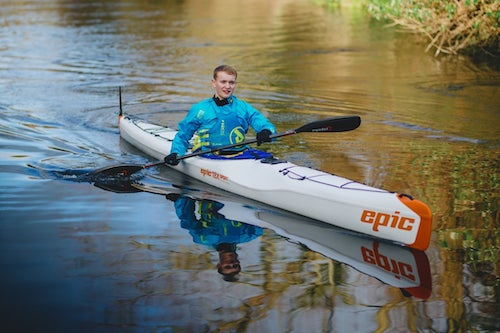 Billy Monger sat in a kayak