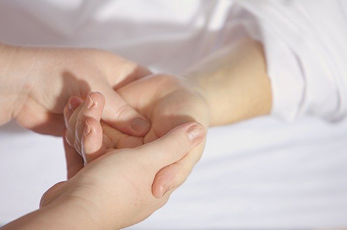 Massaging someone's hand