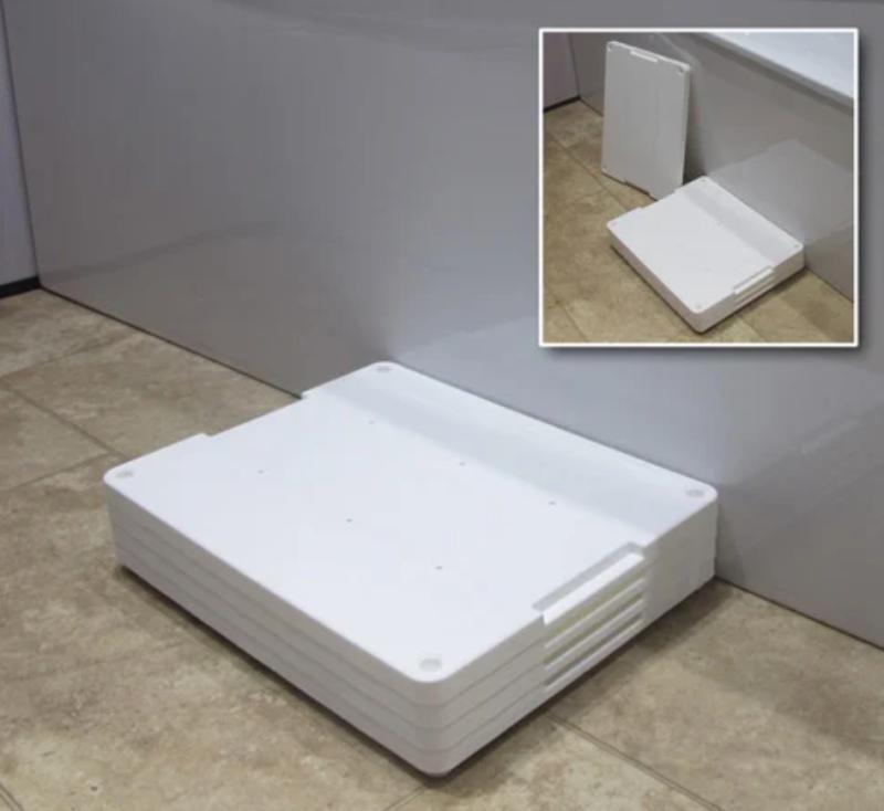 White plastic bath step next to a bath