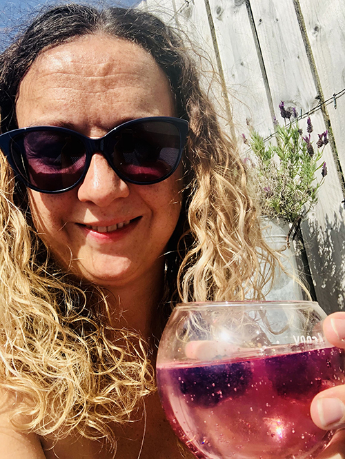Carrie-Ann Lightley is in the garden holding a cocktail