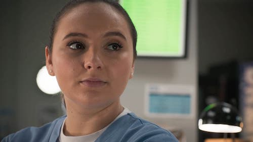 Gabriella Leon as Jade Lovall on Casualty wearing her nurse scrubs