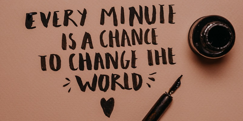 Every minute is a chance to change the world written on pink paper