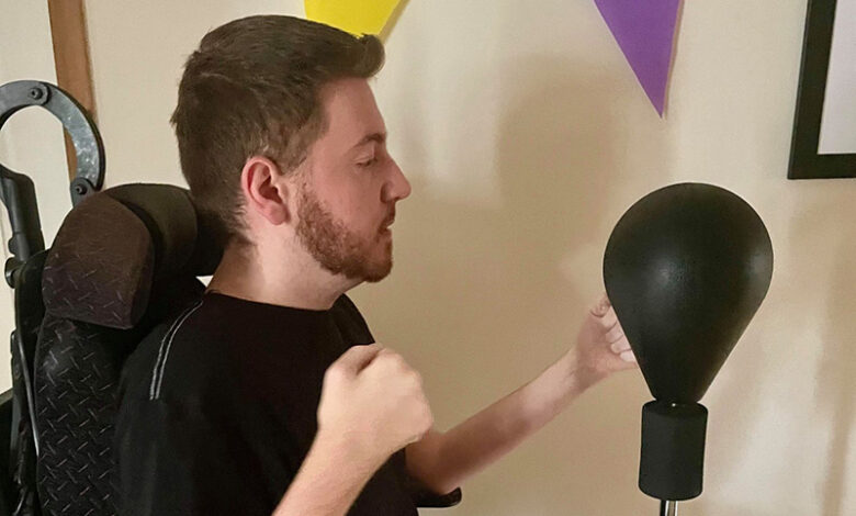 Ross is exercising using a punch bag