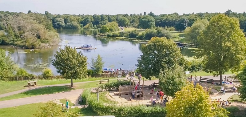 Wheelchair-accessible Ferry Meadows Nene Park with a large lake surrounded by park and trees and a playground